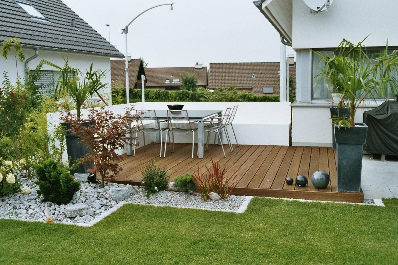 Gartengestaltung  Fischer Gärten von Garten Mit Holz Und Stein Bild