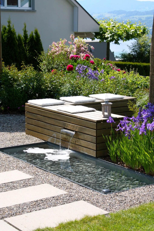 Sitzplatz Zum Wohlfühlen Mit Wasserspiel  Parc's Gartengestaltung von Wasserspiel Garten Stein Photo