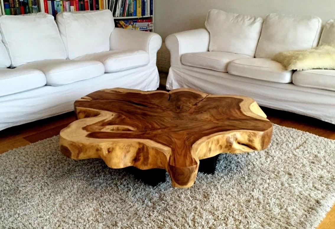 Elegante Holzstamme Als Tisch Couchtisch Mit Tischplatte Aus Einem von Tisch Aus Baumstamm Selber Machen Photo