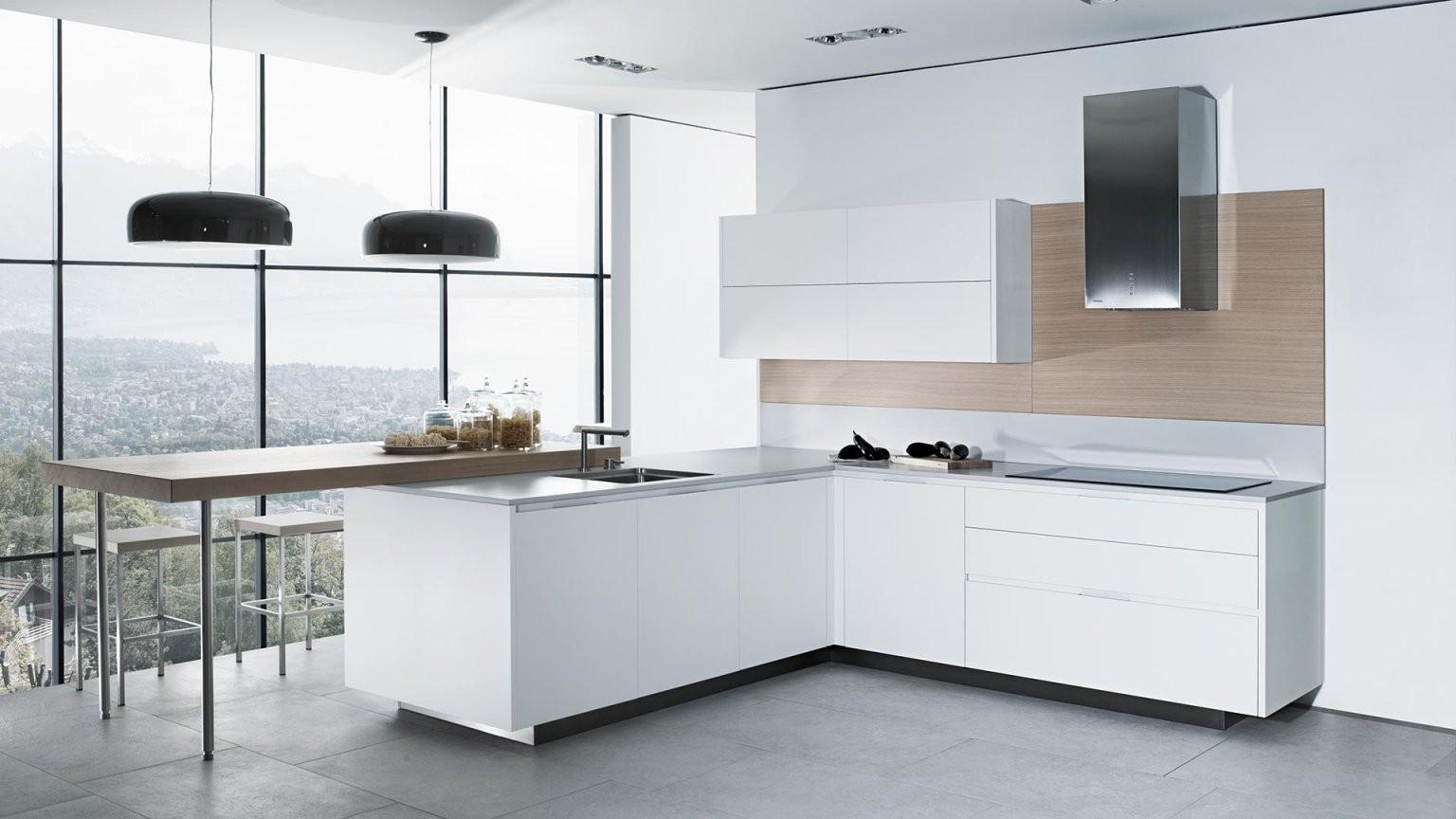 Küchen  Rolf Schubiger von Küche Mit Kochinsel Und Tisch Bild