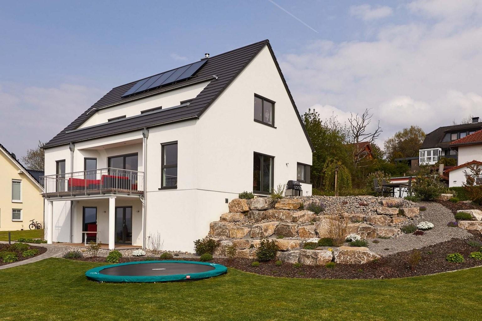 Modell Hellerberge – Exklusives Fertighaus In Hanglage – Fernblick von Einfamilienhaus Am Hang Grundrisse Photo