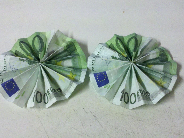 Sonne Aus Geldschein Falten  So Geht's  Anleitung Mit Bildern Und von Geldscheine Falten Blume Mit Einem Schein Photo