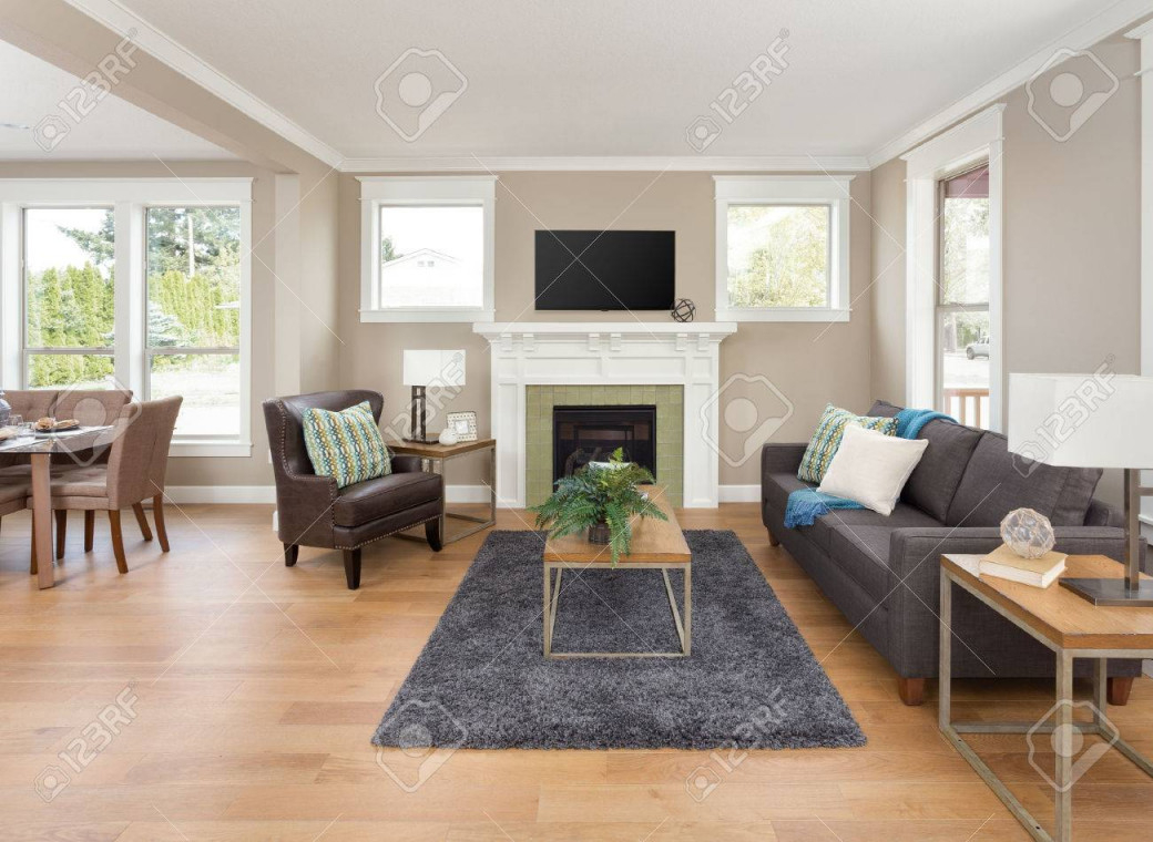 Schöne Wohnzimmer Interieur Mit Parkettboden Und Kamin In Der Neuen Heimat von Schöne Bilder Wohnzimmer Bild