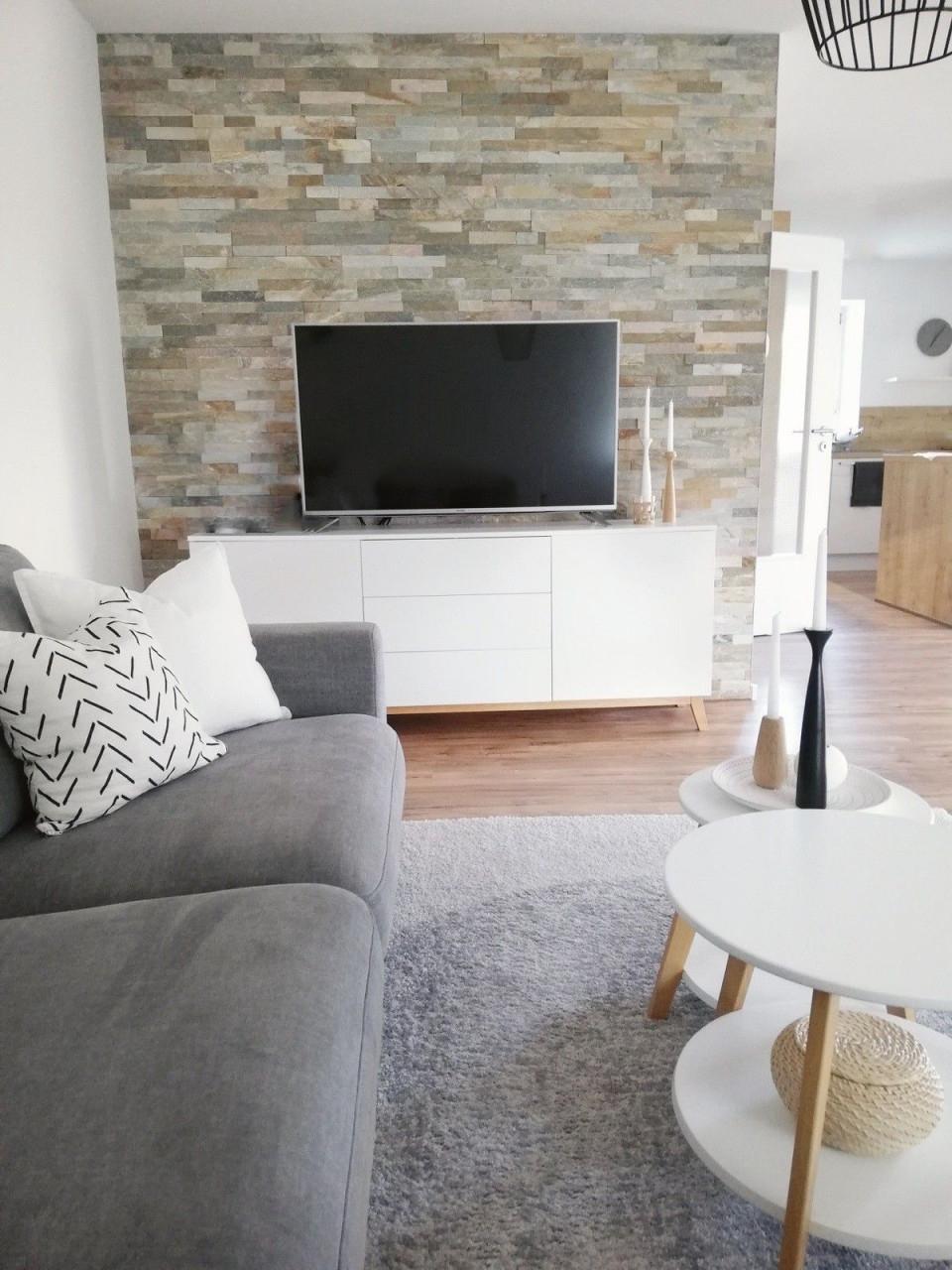Wohnen  Wohnung Wohnzimmer Wohnen Wohnung von Wohnzimmer Mit Steinwand Gestalten Photo