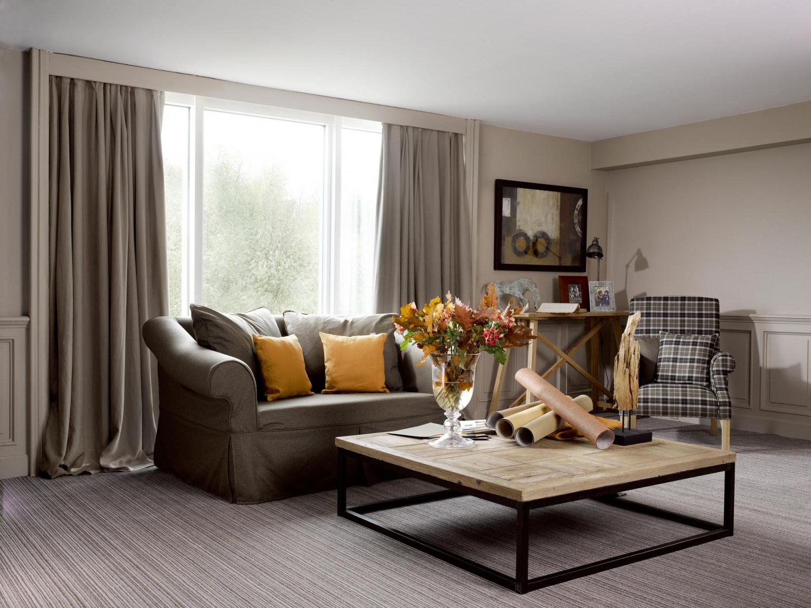 Wohnzimmer Mit Natürlichen Farbtönen Gestalten Couc von Wohnzimmer Mit Teppich Gestalten Bild